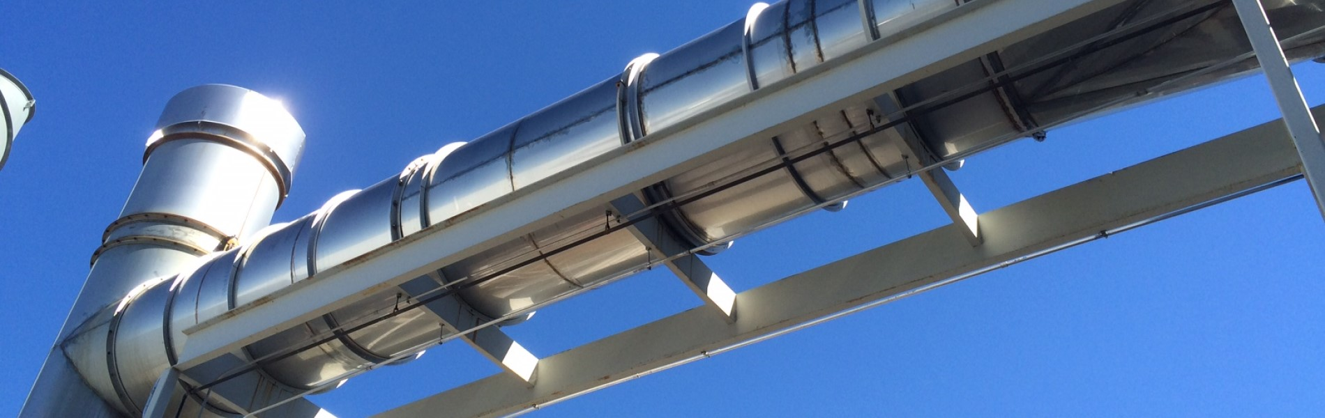 Steel ductwork against blue sky