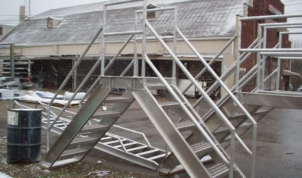 Aluminum conveyor crossover stairs right side view