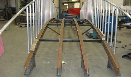 Custom fabricated metal bridge side view