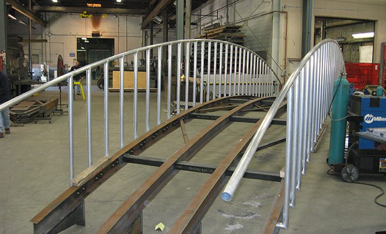 Custom fabricated metal bridge back view