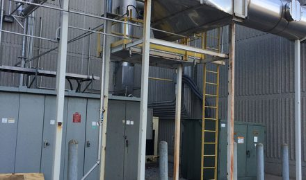 Fabricated stainless steel ductwork outside next to building