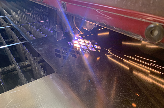 Laser cutting machine being used on galvanized sheet metal