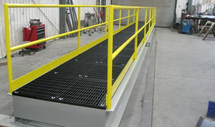 Yellow painted custom steel fabricated platform bridge side view
