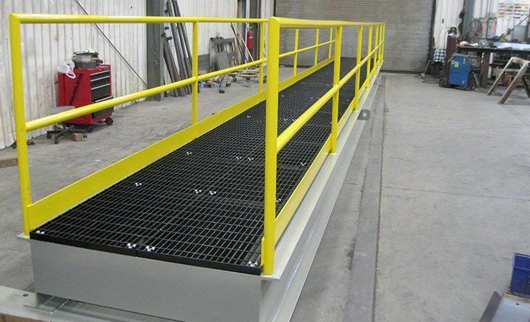 Yellow painted custom steel fabricated platform bridge side view