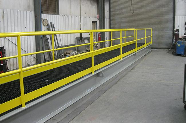 Yellow painted custom steel fabricated platform bridge left angle view