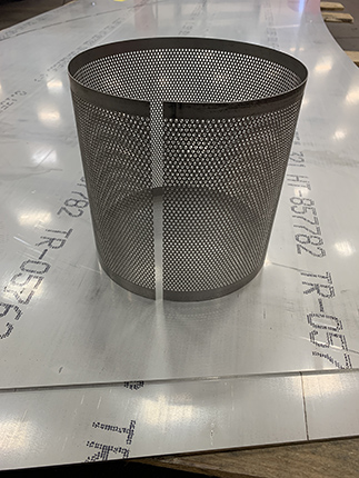 Perforated stainless steel basket