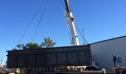 Custom fabricated TVA containment tank being loaded on truck