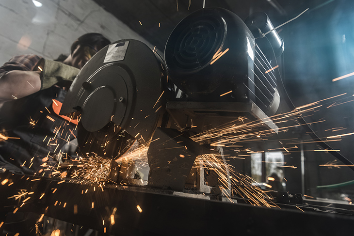 Welder using a welding torch and creating sparks