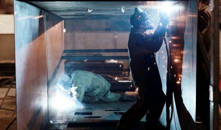 Welders working inside of a steel fabricated tank